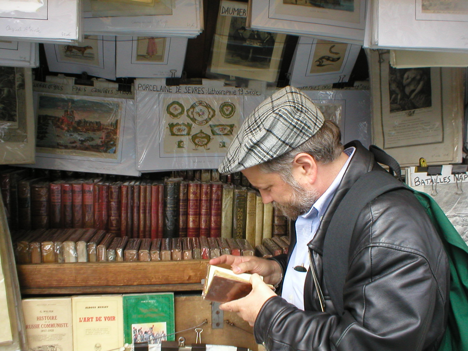 A blind flaneur peruses an edition of Voltaire printed in 1745.
