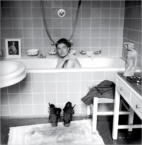 Lee Miller sneaks a bath in Hitler's apartment after the fall of Berlin, 1945; photo by David E. Scherman, Life magazine.
