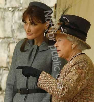 Britain's Queen Elizabeth (R) and France's first lady Carla Bruni watch the Guard of Honour review at Windsor Castle in Windsor, Southern England March 26, 2008. [Source:   REUTERS/Kieran Doherty]