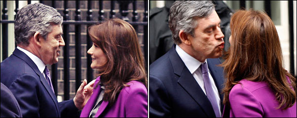 Gordon Brown greets France's first lady Carla Bruni with a kiss on the doorstep of 10 Downing Street. [Source: Telegraph]