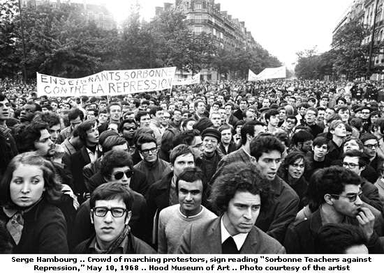 "Protesters march down Boulevard Saint Michel on May 10, 1968. The banner reads: ""Sorbonne Teachers Against Repression. [Photo by Serge Hambourg/via Art Knowledge News]"