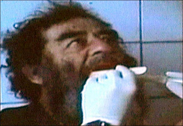 Photo of Saddam Hussein after his capture in December 2003. [Source: NYT 120303]