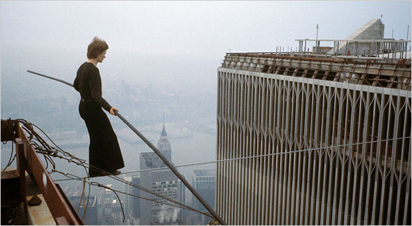 Philippe Petit balances on a wire stretched between the towers of the World Trade Center on August 7, 1974. [Source: NYT/Jean-Louis Blondeau/Polaris]