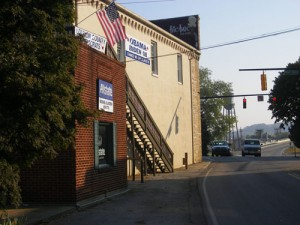 An Obama campaign banner and American flag fly outside Tom's studio in Loudon, Tennesee.