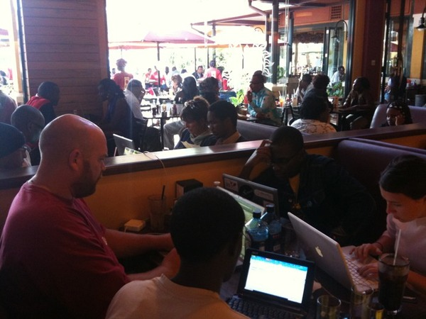 "Six members of Ushahidi's Kenyan team working in an ""ad hoc situation room"" – ak.a. a coffee shop in Nairobi (via @ushahidi on Twitter)"