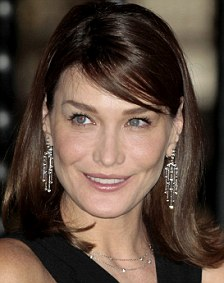 France's First Lady Carla Bruni-Sarkozy smiles during a dinner at the National Palace in Mexico City March 9, 2009. [Source: REUTERS/Henry Romero]