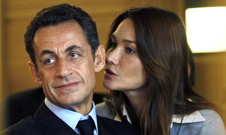 French President Nicolas Sarkozy and his wife Carla Bruni-Sarkozy. [Photo by  Jean-Paul Pelissier/AFP/Guardian.com]