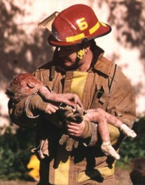 Charles Porter's photograph of firefighter Chris Fields holding the dying infant Baylee Almon won the Pulitzer Prize for Spot News Photography in 1996. [Source: Wikipedia]
