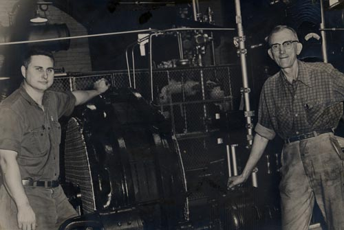 Bob Willis (left) with his helper Roy in the engine room of the Ice Plant , circa 1962.