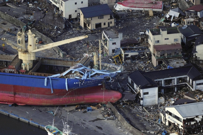 A ship is washed aground in Kamaishi City, Iwate, by the tsunami which followed the Japanese earthquake Source: Reuters/AJE]