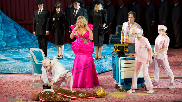 "NO MADAME BUTTERFLY: Anna Nicole Smith, played by Dutch soprano Eva-Maria Westbroek, looks on in horror as J. Howard Marshall, played by Alan Oke, is seen dead on the floor in Covent Garden's production of the opera ""Anna Nicole."" [Photo by Bill Cooper/The Royal Opera/NPR]"