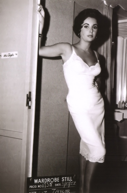Elizabeth Taylor in a wardrobe still shot on the set of the 1958 film Cat on a Hot Tin Roof. [Source: Dr. X's Free Associations]
