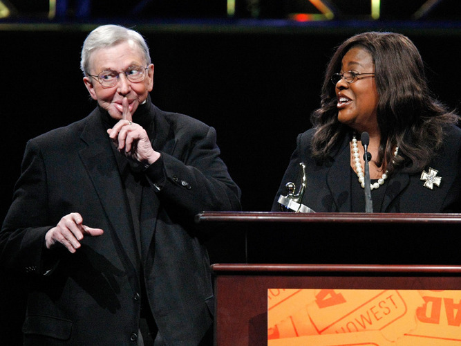 Film critic Roger Ebert accompanied by his wife Chaz, accepts a career-achievement award at the theater-owners' convention ShoWest in 2009. [Source: Ethan Miller/Getty Images/NPR]